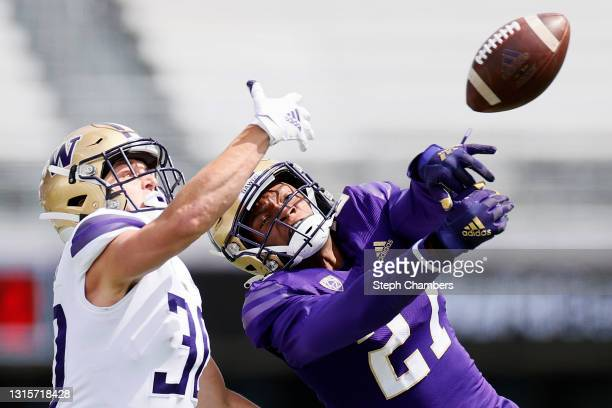 Defensive back James Smith of the Washington Huskies deflects a pass intended for wide receiver David Pritchard of the Washington Huskies in the...