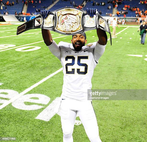 Defensive back Jason Hendricks of the Pittsburgh Panthers celebrates with a World Wrestling Entertainment belt on the field after a game against the...