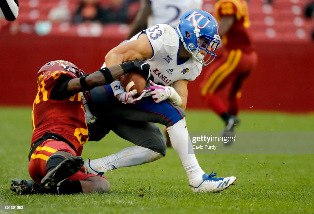 Defensive back Jatairis Grant #21 of the Iowa State Cyclones tackles wide receiver Ryan Schadler #33 of the Kansas Jayhawks as he rushed for yards in the second half of play at Jack Trice Stadium on October 14, 2017 in Ames, Iowa. The Iowa State Cyclones won 45-0 over the Kansas Jayhawks.