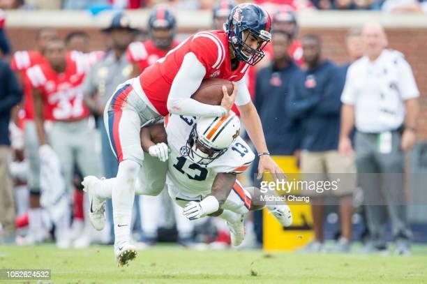 Defensive back Javaris Davis of the Auburn Tigers sacks quarterback Jordan Ta'amu of the Mississippi Rebels during the first quarter at...