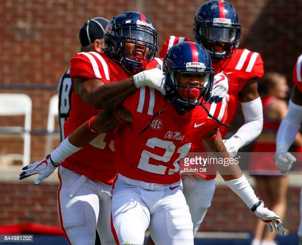 Defensive back Javien Hamilton of the Mississippi Rebels celebrates after he intercepted a pass during the second half of an NCAA football game...