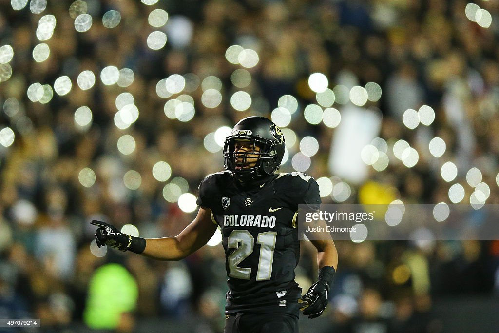 Defensive back Jered Bell #21 of the Colorado Buffaloes prepares for the play as the student section uses their phones in the background during the second quarter against the USC Trojans at Folsom Field on November 13, 2015 in Boulder, Colorado.