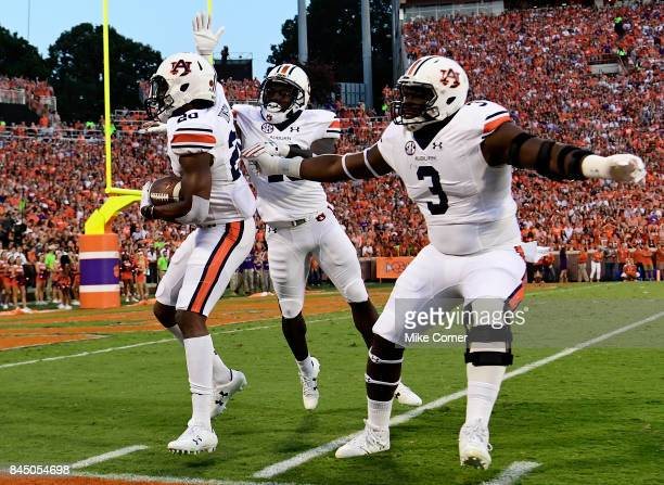 Defensive back Jeremiah Dinson defensive lineman Marlon Davidson and defensive back Javaris Davis of the Auburn Tigers celebrate after Auburn...
