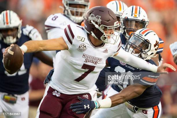 Defensive back Jeremiah Dinson of the Auburn Tigers looks to sack quarterback Tommy Stevens of the Mississippi State Bulldogs during the first...