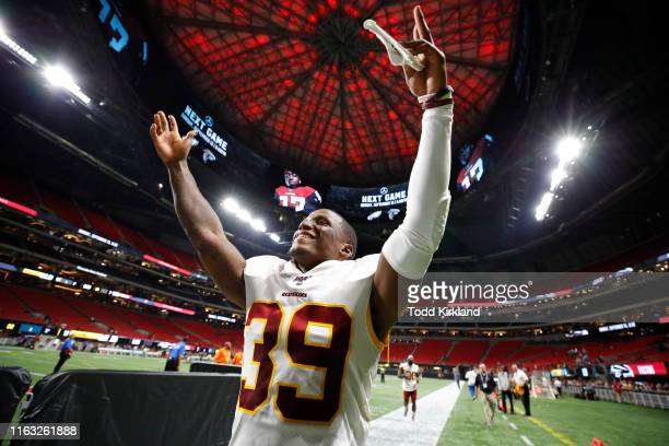 Defensive back Jeremy Reaves of the Washington Redskins reacts at the conclusion of an NFL preseason game against the Atlanta Falcons at...