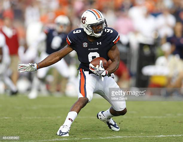 Defensive back Jermaine Whitehead of the Auburn Tigers intercepts a pass during the game against the Arkansas Razorbacks at Jordan Hare Stadium on...