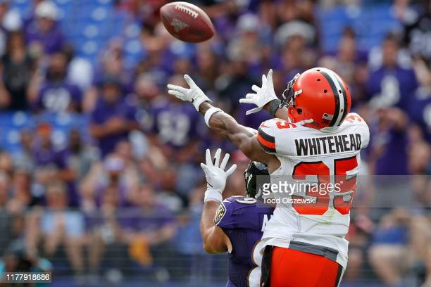 Defensive Back Jermaine Whitehead of the Cleveland Browns catches an interception in the second half against the Baltimore Ravens at MT Bank Stadium...