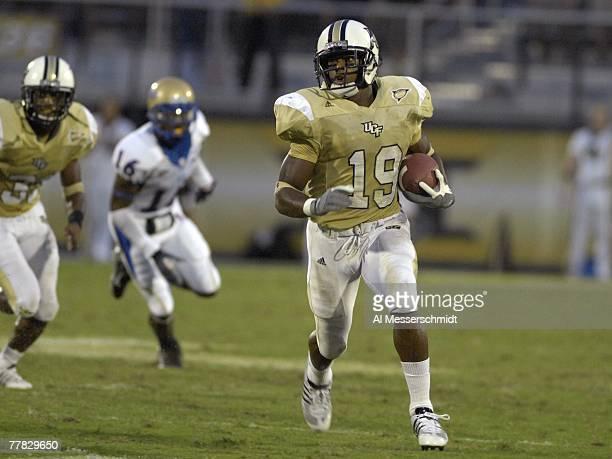 Defensive back Joe Burnett of the University of Central Florida Golden Knights rushes upfield against the Tulsa Golden Hurricane at Bright House...