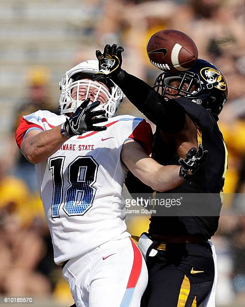 Defensive back John Gibson of the Missouri Tigers breaks up a pass indended for wide receiver Mason Rutherford of the Delaware State Hornets during...