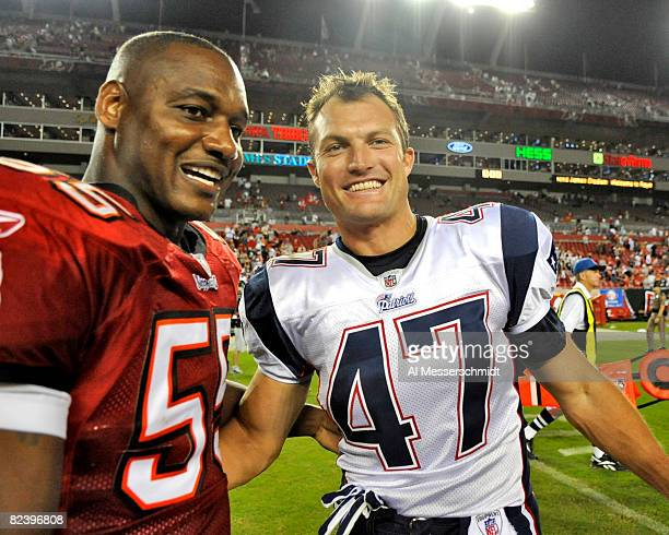 Defensive back John Lynch of the New England Patriots greets linebacker Derrick Brooks of the Tampa Bay Buccaneers after play at Raymond James...