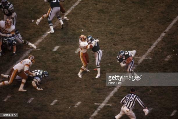 Defensive back John Sciarra of the Philadelphia Eagles returns an interception against the Washington Redskins on December 6 in Washington DC The...
