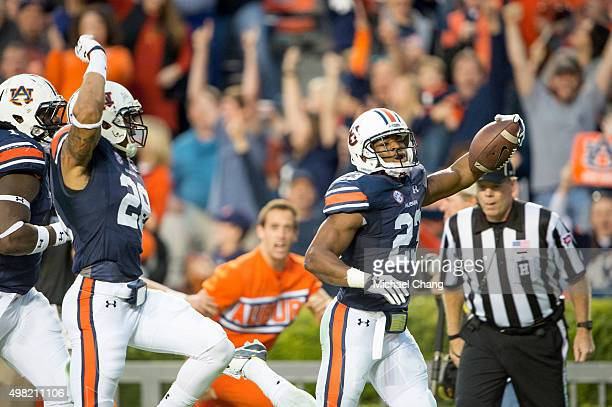 Defensive back Johnathan Ford celebrates with defensive back Tray Matthews and defensive tackle Montravius Adams of the Auburn Tigers after scoring a...