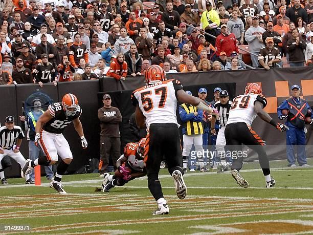 Defensive back Johnathan Joseph of the Cincinnati Bengals intercepts a pass intended for tight end Steve Heiden of the Cleveland Browns during a game...