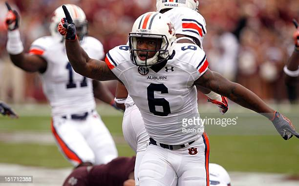 Defensive back Jonathon Mincy of the Auburn Tigers celebrates a fumble recovery in the first quarter of a NCAA college football game against...