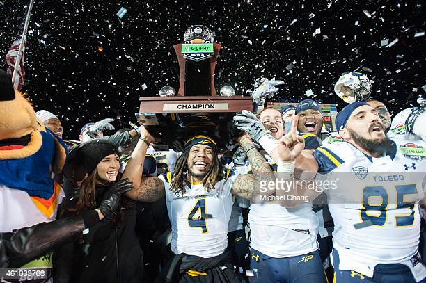 Defensive back Jordan Haden of the Toledo Rockets holds up the GoDaddy trophy while celebrating with other teammates on January 4 2015 at LaddPeebles...