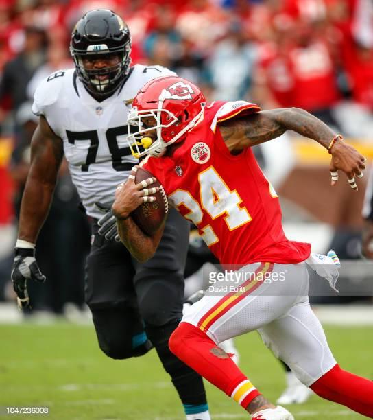 Defensive back Jordan Lucas of the Kansas City Chiefs returned a fourth quarter interception past offensive tackle Jermey Parnell of the Jacksonville...