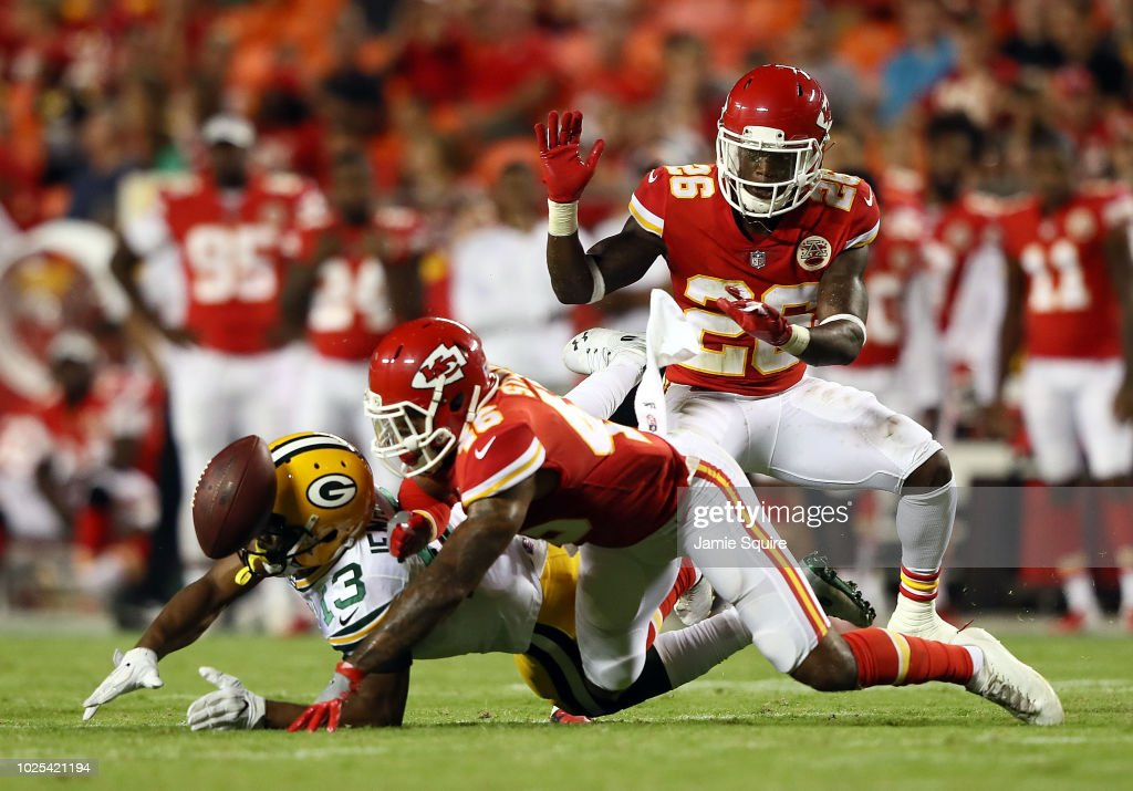 Defensive back Jordan Sterns #46 of the Kansas City Chiefs breaks up a pass intended for wide receiver Adonis Jennings #13 of the Green Bay Packers during the preseason game at Arrowhead Stadium on August 30, 2018 in Kansas City, Missouri.