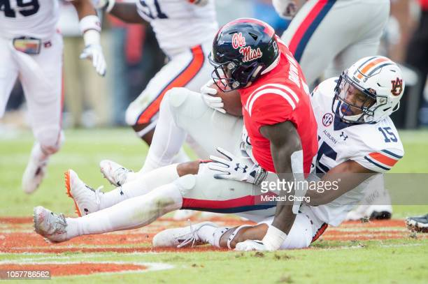 Defensive back Jordyn Peters of the Auburn Tigers tackles wide receiver AJ Brown of the Mississippi Rebels at VaughtHemingway Stadium on October 20...