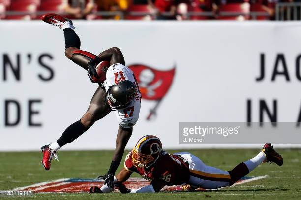 Defensive back Josh Wilson of the Washington Redskins hits receiver Arrelious Benn of the Tampa Bay Buccaneers during the game at Raymond James...