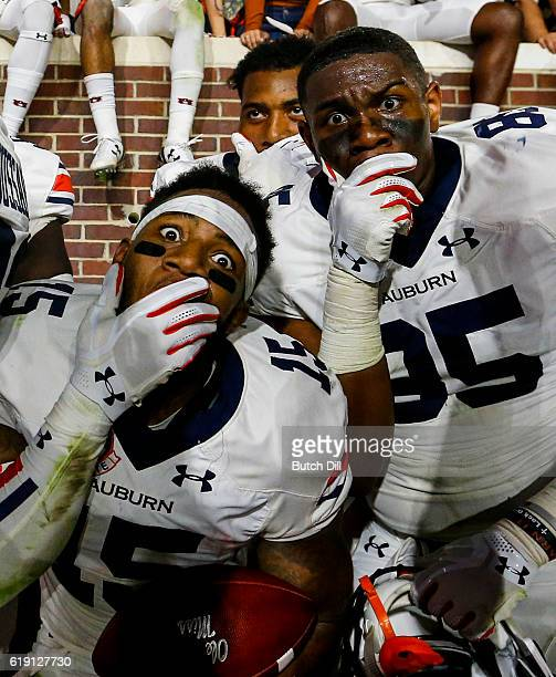 Defensive back Joshua Holsey of the Auburn Tigers and tight end Jalen Harris of the Auburn Tigers celebrate with fans after they defeated the...