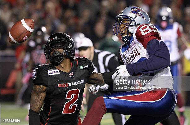 Defensive back Jovon Johnson of the Ottawa Redblacks blocks wide receiver Duron Carter of the Montreal Alouettes from making the catch in the second...