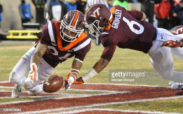 Defensive back Jovonn Quillen of the Virginia Tech Hokies recovers a blocked punt in the end zone against the Virginia Cavaliers in the first half at...