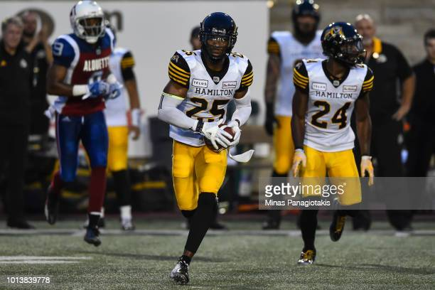 Defensive back Jumal Rolle of the Hamilton TigerCats runs with the ball against the Montreal Alouettes during the CFL game at Percival Molson Stadium...