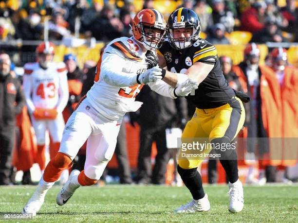 Defensive back Justin Currie of the Cleveland Browns engages tight end Vance McDonald of the Pittsburgh Steelers in the first quarter of a game on...