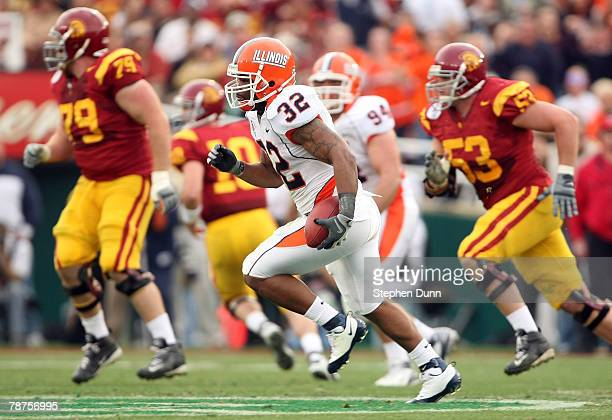 Defensive back Justin Harrison of the Illinois Fighting Illini runs the ball back on an interception in the first quarter against the USC Trojans...