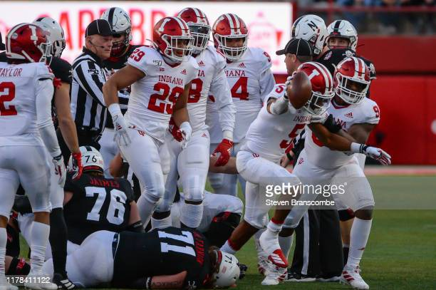 Defensive back Juwan Burgess of the Indiana Hoosiers celebrates with the team after a fumble recovery against the Nebraska Cornhuskers at Memorial...