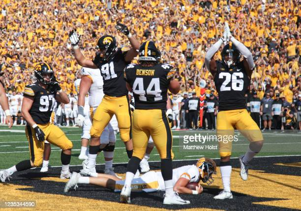 Defensive back Kaevon Merriweather of the Iowa Hawkeyes signals a safety while celebrating with linebacker Seth Benson during the first half over top...