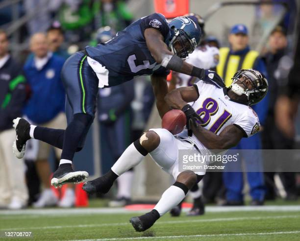 Defensive back Kam Chancellor of the Seattle Seahawks collides with wide receiver Anquan Boldin during a game at CenturyLink Field on November 13,...