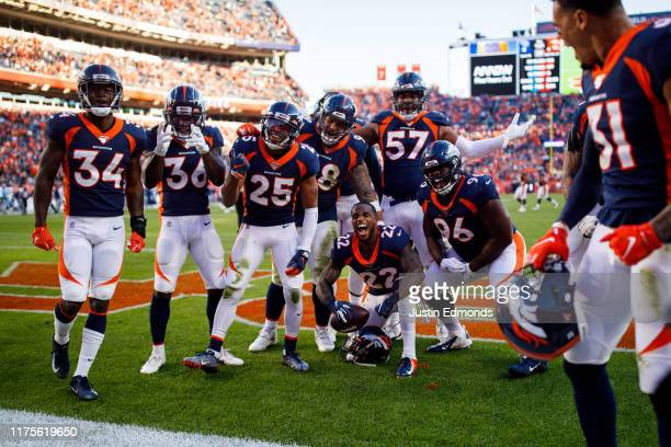 Defensive back Kareem Jackson of the Denver Broncos celebrates in the end zone with the rest of the defense after an interception late in the fourth...