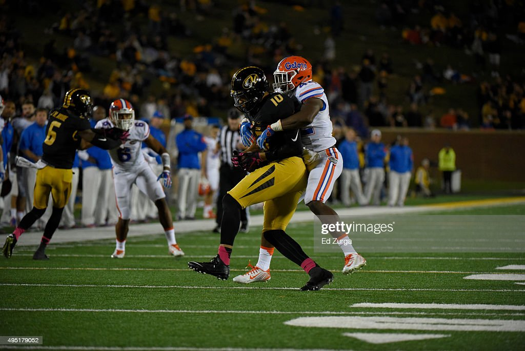 Defensive back Keanu Neal #42 of the Florida Gators tackles tight end Jason Reese #10 of the Missouri Tigers at Memorial Stadium on October 10, 2015 in Columbia, Missouri.