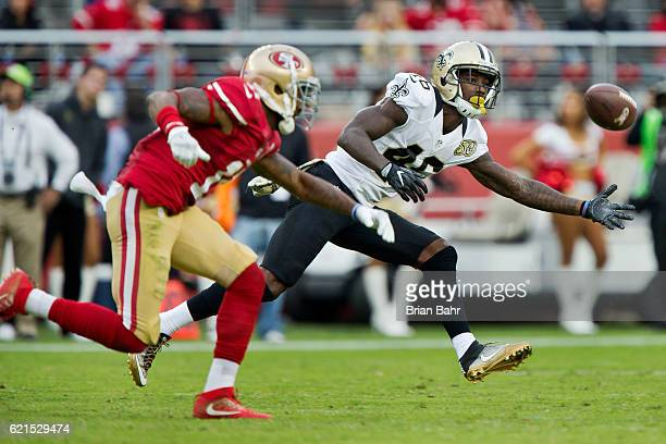 Defensive back Ken Crawley of the New Orleans Saints nearly comes up with the ball against wide receiver Quinton Patton of the San Francisco 49ers in...