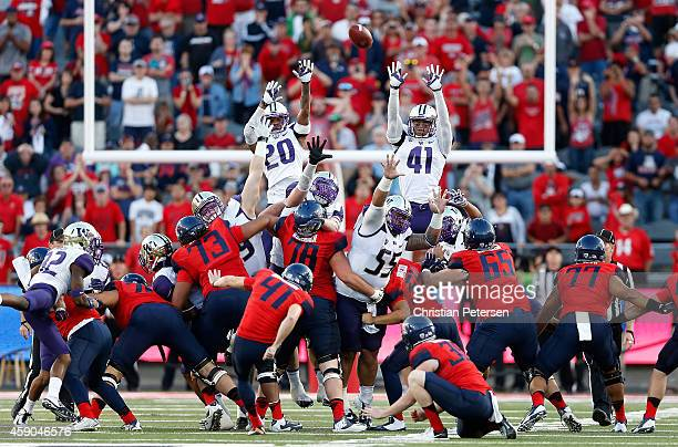 Defensive back Kevin King defensive lineman Danny Shelton and linebacker Travis Feeney of the Washington Huskies attempt to block the game winning 47...