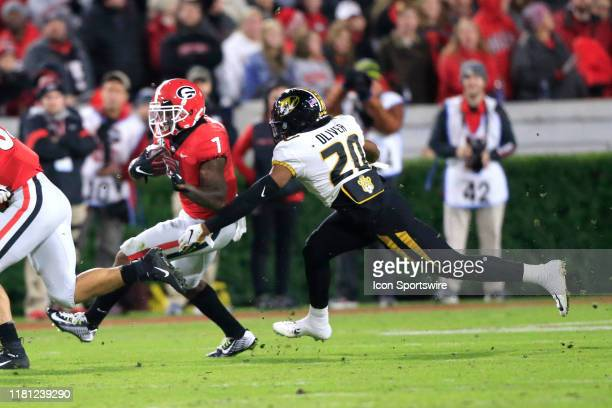 Defensive back Khalil Oliver of the Missouri Tigers reaches for running back D'Andre Swift of the Georgia Bulldogsduring the college football game...