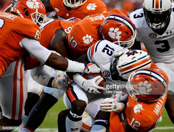 Defensive back K'Von Wallace safety Tanner Muse and linebacker Dorian O'Daniel of the Clemson Tigers group tackle wide receiver Eli Stove of the...
