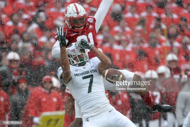 Defensive back Lamar Jackson of the Nebraska Cornhuskers interferes with wide receiver Cody White of the Michigan State Spartans on a pass in the...