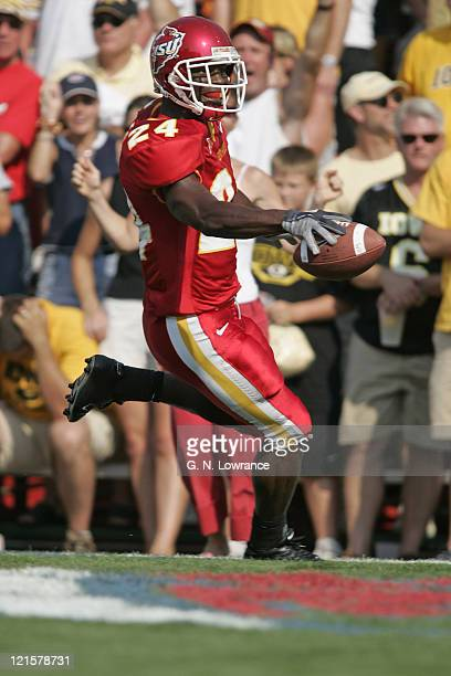 Defensive back LaMarcus Hicks of the Iowa State Cyclones scores a touchdown on a 28 yard interception return during a game against the Iowa Hawkeyes...