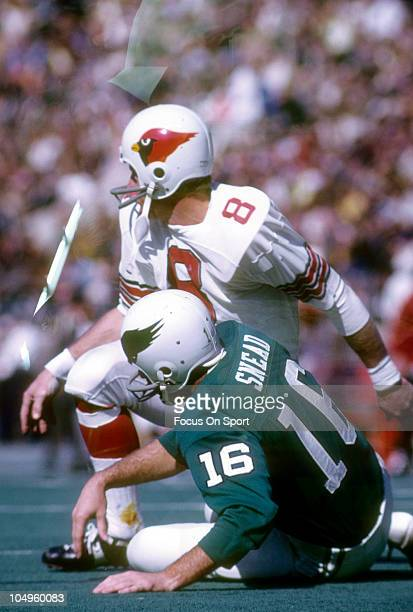 Defensive Back Larry Wilson of the St Louis Cardinals knocks to the ground quarterback Norm Snead of the Philadelphia Eagles during an NFL football...