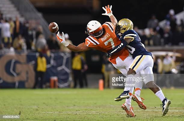 Defensive back Lawrence Austin of the Georgia Tech Yellow Jackets breaks up a pass intended for tight end Bucky Hodges of the Virginia Tech Hokies in...