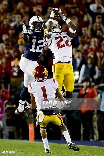 Defensive back Leon McQuay III of the USC Trojans intercepts a pass in the fourth quarter against the Penn State Nittany Lions during the 2017 Rose...