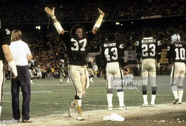 Defensive back Lester Hayes of the Los Angeles Raiders gives the touchdown sign has the Raiders score against the Washington Redskins during Super...