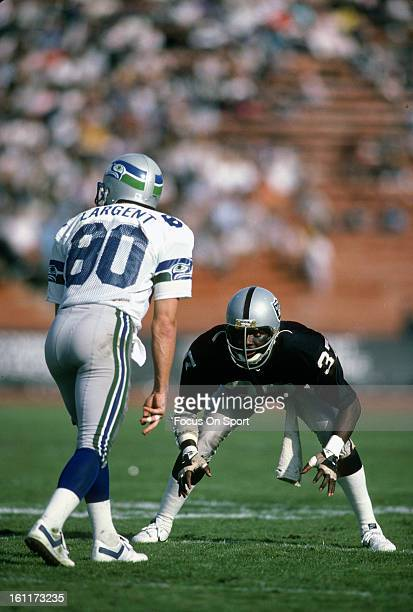 Defensive back Lester Hayes of the Los Angeles Raiders in action guarding wide receiver Steve Largent of the Seattle Seahawks during an NFL football...