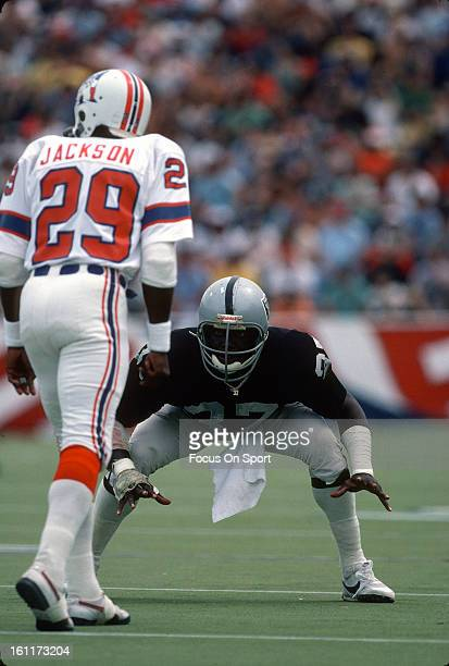 Defensive back Lester Hayes of the Oakland Raiders guards Harold Jackson of the New England Patriots during an NFL football game circa 1981 at...