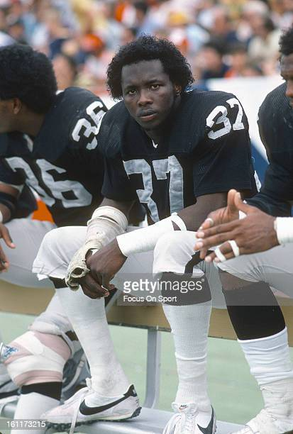 Defensive back Lester Hayes of the Oakland Raiders looks on from the bench against the New England Patriots during an NFL football game circa 1981 at...