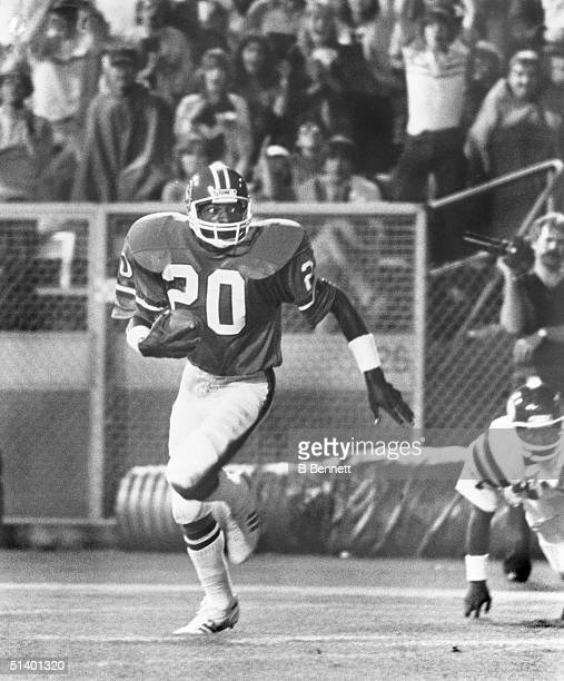 Defensive back Louis Wright of the Denver Broncos runs with the ball on an open field during a game Louis Wright played for the Denver Broncos from...