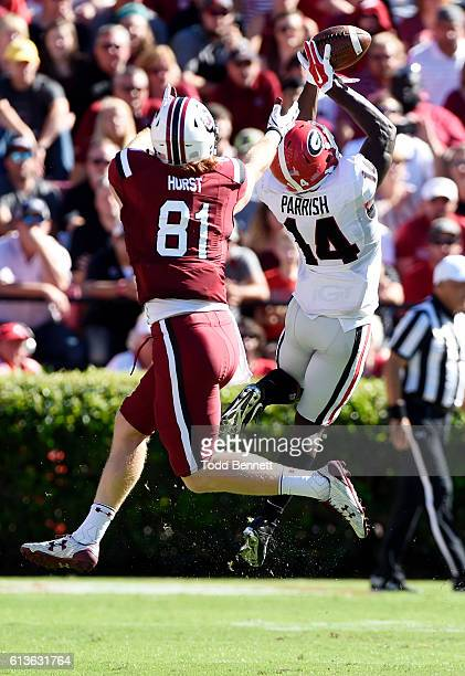Defensive back Malkom Parrish of the Georgia Bulldogs intercepts a pass intended for tightend Hayden Hurst of the South Carolina Gamecocks during the...