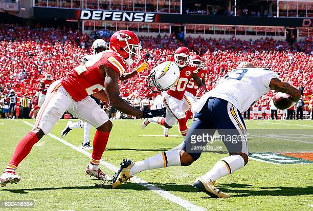 Defensive back Marcus Peters of the Kansas City Chiefs rips the helmet off of wide receiver Keenan Allen of the San Diego Chargers during the game at...
